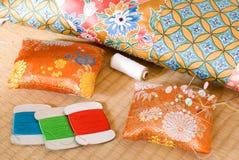 Pin cushion and mattresses Royalty Free Stock Image
