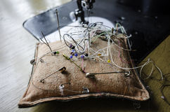 Pin cushion with needles and pins Royalty Free Stock Image