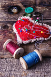 Pin cushion with needles Royalty Free Stock Images