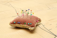 Pin cushion and paper sewing pattern Stock Photography