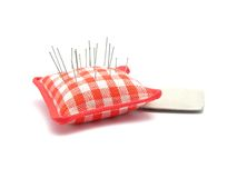 Pin cushion with pins and chalk Stock Photo