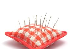Pin cushion with several pins Stock Photo
