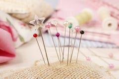 Pin cushion with sewing pins Royalty Free Stock Image