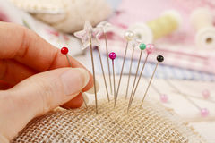 Pin cushion with sewing pins Royalty Free Stock Photos