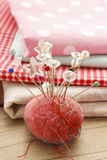 Pin cushion with sewing pins Royalty Free Stock Photo