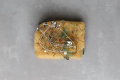 Pin cushion with sewing pins Stock Image