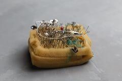 Pin cushion with sewing pins Royalty Free Stock Photos