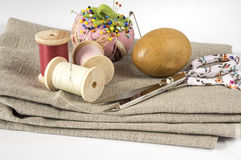 Pin cushion, threads and other sewing utensils Royalty Free Stock Photo