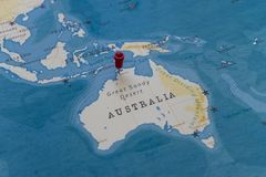 A pin on darwin, australia in the world map.  stock photos