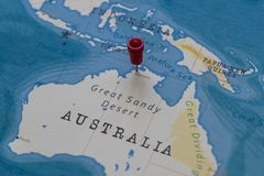 A pin on darwin, australia in the world map.  royalty free stock images