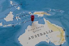 A pin on darwin, australia in the world map.  royalty free stock photography