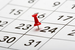 Pin on the date number 24. Usually Christmas day. Pin on the date number 24. The twentyfourth day of the month is marked with a red thumbtack. Focus point on Royalty Free Stock Image