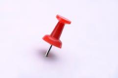Pin en plastique rouge de poussée Image stock