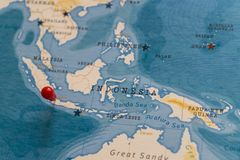 A pin on jakarta, indonesia in the world map.  royalty free stock photo
