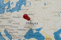 A pin on kiev, ukraine in the world map royalty free stock photography