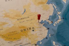 A pin on beijing, china in the world map stock images