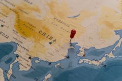 A pin on beijing, china in the world map stock image