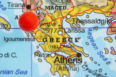 Pin on a map of Greece. Close-up of a red pushpin on a map of Greece stock photography