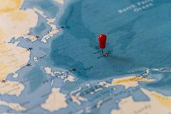 A pin on guam, usa in the world map royalty free stock photography