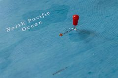 A pin on hawaii in the world map stock photography