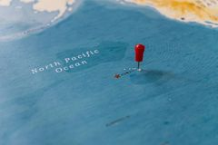 A pin on hawaii in the world map royalty free stock photo