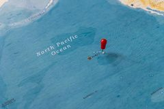 A pin on hawaii in the world map royalty free stock image