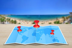 Pin map iconon a blue map Royalty Free Stock Photo