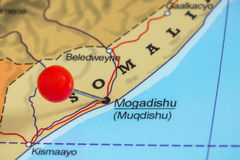Pin on a map of Mogadishu. Close-up of a red pushpin on a map of Mogadishu, Somalia stock photo