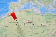 Pin in map of Sahara Desert Stock Images