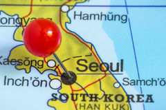 Pin on a map of Seoul. Close-up of a red pushpin on a map of Seoul, South Korea Stock Photography