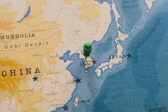A pin on seoul, south korea in the world map royalty free stock image