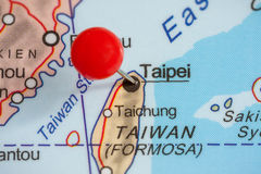 Pin on a map of Taipei. Close-up of a red pushpin on a map of Taipei, Taiwan royalty free stock images