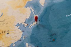 A pin on tokyo, japan in the world map stock photography