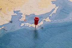 A pin on tokyo, japan in the world map royalty free stock image