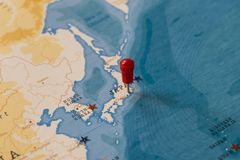 A pin on tokyo, japan in the world map royalty free stock photography