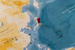 A pin on tokyo, japan in the world map royalty free stock photos