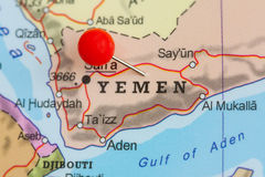 Pin on a map of Yemen. Close-up of a red pushpin on a map of Yemen Royalty Free Stock Photo