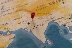 A pin on New Delhi, India in the world map royalty free stock photography