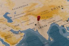 A pin on New Delhi, India in the world map.  royalty free stock photo
