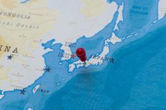 A pin on osaka, japan in the world map.  stock photo