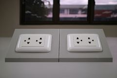 3-pin outlet on table office Royalty Free Stock Photos