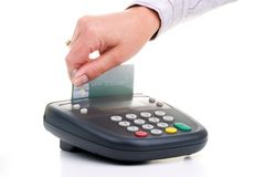 Pin Pad - credit card swipe. Cusomer swipe credit card on pin pad card reader over white background Royalty Free Stock Image