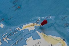 A pin on port moresby, papua new guinea in the world map.  stock photo