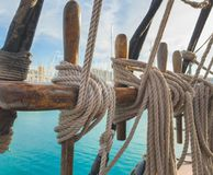 Pin rail with fixed ropes. An old sailing ship royalty free stock photos
