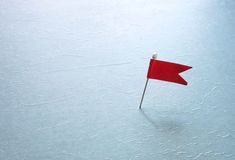 Pin with red flag Stock Photos