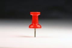 Pin rojo del empuje Foto de archivo libre de regalías