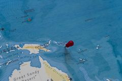A pin on Solomon Islands in the world map.  royalty free stock photo