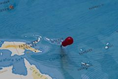 A pin on Solomon Islands in the world map.  stock photography