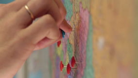 Pin specify the location on the map closeup stock video footage