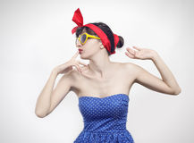 Pin up. Girl with yellow sunglasses Royalty Free Stock Photo